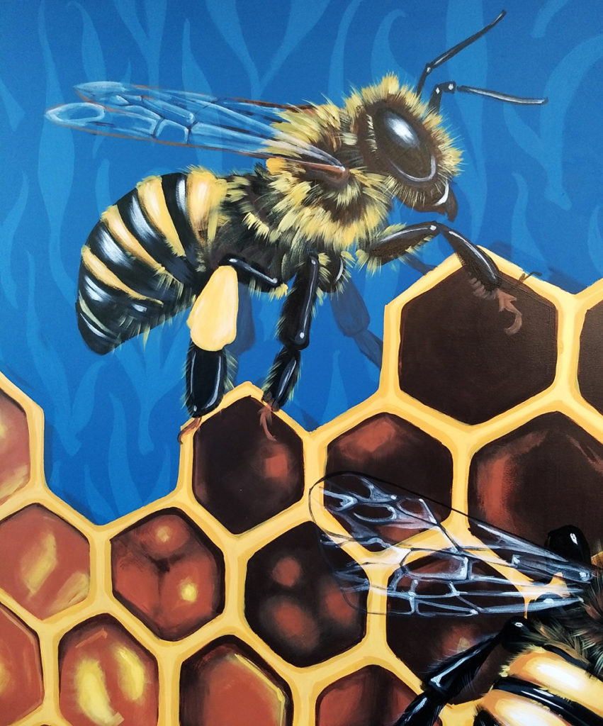 A close up of Sophy Tuttle's bee mural in Salem, MA