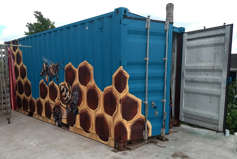 Sophy Tuttle's bee mural on a shipping container.