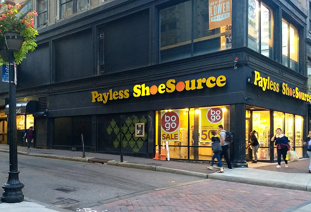 Sophy Tuttle's mural for Last Seen on the side of the Payless Shoe store in Boston.